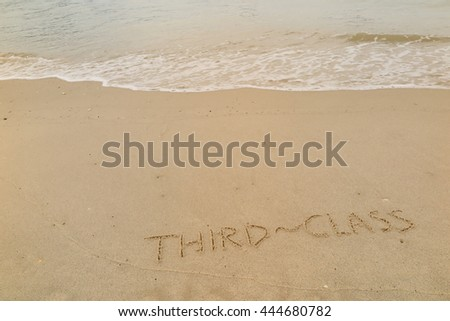 "written words ""THIRD - CLASS"" on sand of beach"