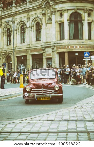 Wroclaw- August 18: Old red car on Motoclassic show on vintage effect  in Wroclaw, Poland on August 18, 2014. - stock photo