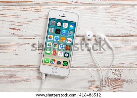 WROCLAW, POLAND - APRIL 12, 2016: Apple iPhone SE smartphone with main menu on screen - stock photo