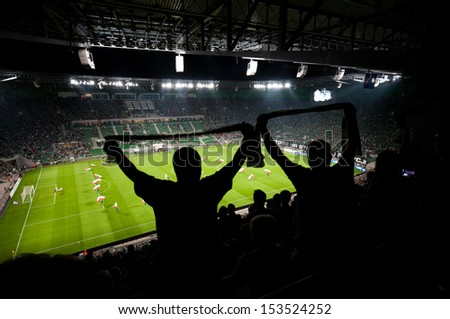 WROCLAW, POLAND - August 29:UEFA Europa League, Stadium with fans silhouettes on football match, Slask Wroclaw vs Sevilla on August 29, 2013 in Wroclaw, Poland. - stock photo
