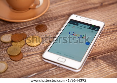 WROCLAW, POLAND - JANUARY 10, 2014: Photo of Samsung Galaxy S II device with google.com homepage on its screen - stock photo