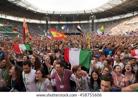 WROCLAW, POLAND - JULY 23, 2016: Pilgrims of the World Youth Day during concert Singing Europe. The concert is part of the Days in the Dioceses of World Youth Day and the European Capitol of Culture.
