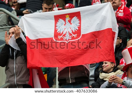 WROCLAW, POLAND - MARCH 26, 2016: Polish fans during the friendly football match between Poland and Finnland at the Municipal Stadium in Wroclaw. - stock photo