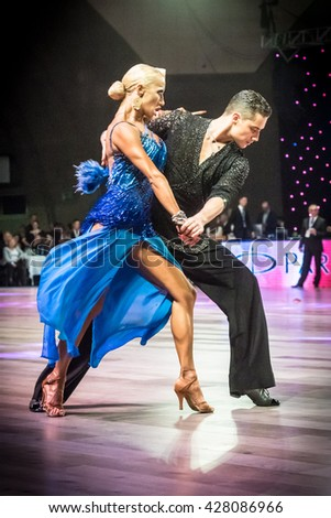 Wroclaw, Poland - May 14, 2016: An unidentified dance couple dancing latin dance during World Dance Sport Federation International Latin Adult Dance, on May 14 in Wroclaw, Poland - stock photo