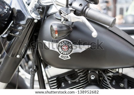 """WROCLAW, POLAND - MAY 18: Detail of Harley Davidson motorcycle parked in the city during """"Harley-Davidson Super Rally 2013"""" on May 18, 2013 in Wroclaw, Poland. Europe's largest 5 day motorcycle event - stock photo"""