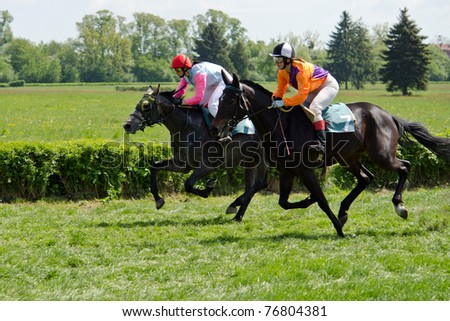WROCLAW, POLAND - MAY 08: M. Kryszylowicz on a horse Bastion (1) and A. Stasiak on a horse  Elkantara (7) finish in a Racecourse Partynice on May 08,2011 in Wroclaw, Poland. - stock photo