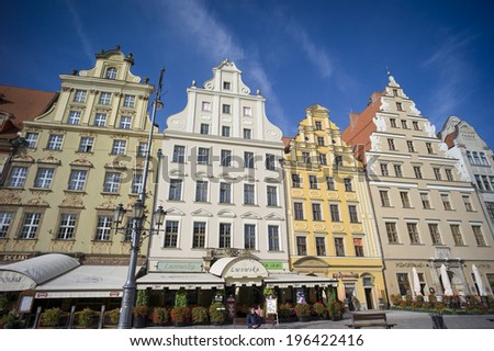 WROCLAW, POLAND - OCT 25: Tenements on Main Market Square on October 25, 2013 in Wroclaw, Poland.  The plaza itself is one of the largest medieval squares in Poland and even in Europe.