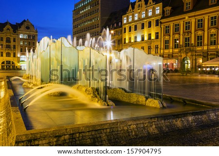 WROCLAW, POLAND - OCTOBER 08: Modern fountain by Alojzy Gryt built with glass panels in year 2000 on the western side of the old Market Square in Wroclaw in Poland on October 08, 2013