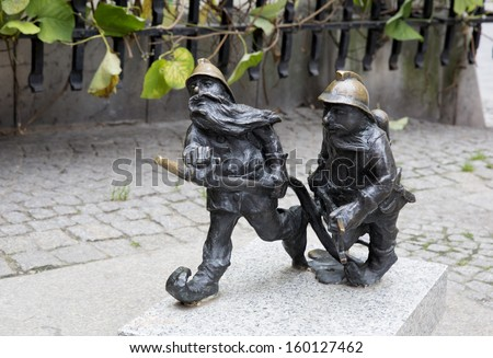 WROCLAW, POLAND - OCTOBER 22: Sculpture of gnome from fairy-tale made by Tomasz Moczek on the street on October 22, 2013 in Wroclaw, Poland. The more than 250 gnomes are touristic symbol of the city.