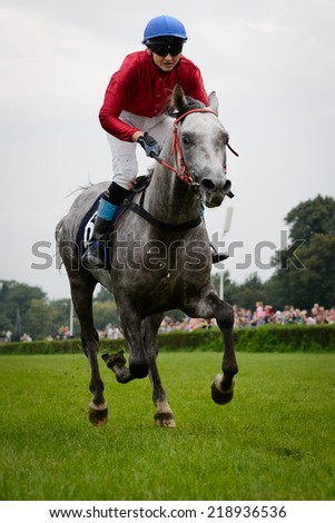 WROCLAW, POLAND - SEPTEMBER 21; 2014: Jockey J. Fornal-Laskosz on horse Elgaro during the race for - three year old arabian horse in a Racecourse WTWK Partynice.  - stock photo