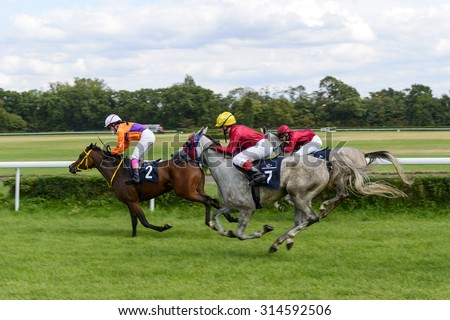 WROCLAW, POLAND - SEPTEMBER 5: Race for 3-year-old Arabian horse group II on 5 September 2015 in Wroclaw, Poland. The winner of the first race this horse Empera No. 7 the jokey A. Tokarek - stock photo