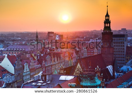 Wroclaw, popular travel destination place. Square in the center of city full of historical medieval architecture and old apartment house. - stock photo