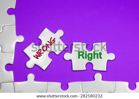 Wrong and Right word on white puzzle - Business Concept - stock photo