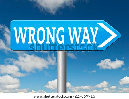 wrong way big mistake turn back getting lost by taking wrong directions  - stock photo