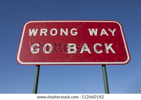 Wrong way go back road sign. - stock photo