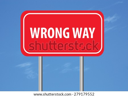 wrong way sign with sky in the background - stock photo