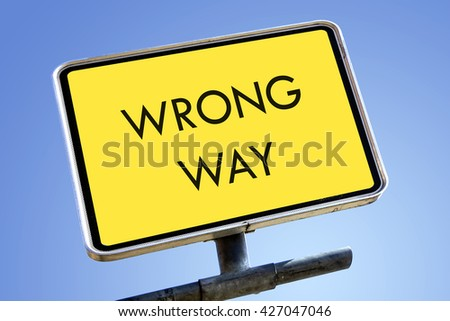 WRONG WAY word on road sign concept - stock photo