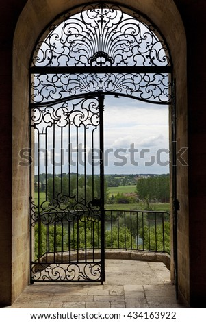 Wrought iron and balcony facing the countryside in South-West of France