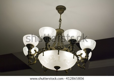 Wrought iron chandelier and painted glass  - stock photo