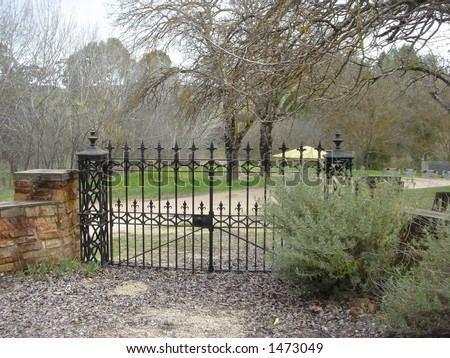 wrought iron country gate landscape - stock photo