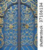 Wrought iron door decoration closeup. More of this motif & more decors in my port. - stock photo