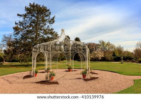 Wrought iron pergola in a park. - stock photo