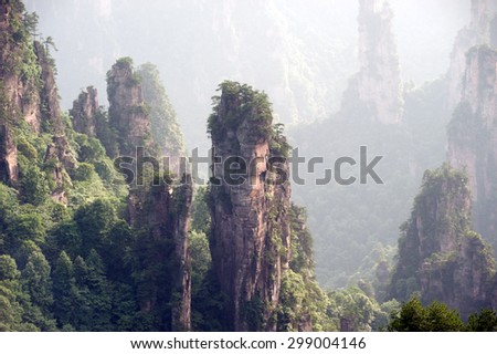 Wulingyuan Scenic Area, part of Zhangjiajie National Forest Park in China, is a charming tourist attraction. It is said to be 'The fairyland' and was admitted to the 'World Heritage List' in 1992. - stock photo