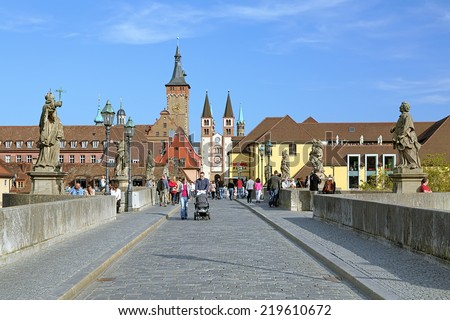 WURZBURG, GERMANY - SEPTEMBER 28, 2013: View over the Old Main Bridge on the Old City Hall and Wurzburg Cathedral. The bridge was built in 1473-1543, statues of saints was erected in 1720 and 1730. - stock photo