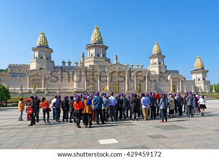 WUXI, CHINA - April 18, 2016: Group of tourist standing in front of Ling Shan Buddha Palace, Ling Shan, Wuxi, Jiangshu Province, China - stock photo