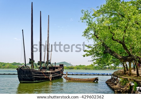 WUXI, CHINA - April 18, 2016: Old wooden ship at Taihu Lake. Taihu Lake is one of the five largest freshwater lakes in China. - stock photo