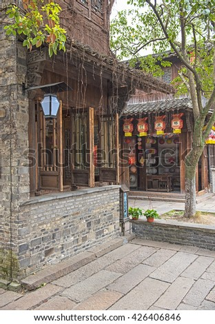 WUZHEN, CHINA - 30 MARCH, 2016: Narrow street in the old town of Wuzhen.Wuzhen water village is Shanghai tourist attraction with more than 100000 visitors per year.