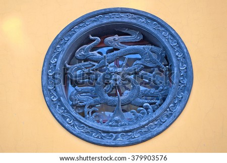 WUZHEN, SHANGHAI-DECEMBER 2, 2008: dragons in Foguangpuzhao  temple   window decoration. Wuzhen water village is Shanghai tourist attraction with more than 100000 visitors per year. - stock photo