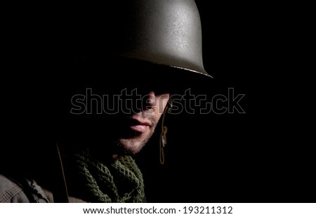 WW2 American Soldier With Face In Deep Shadow - stock photo
