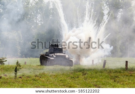 WW2 German light tank Panzer 38 (t), and the explosion of a shell hit