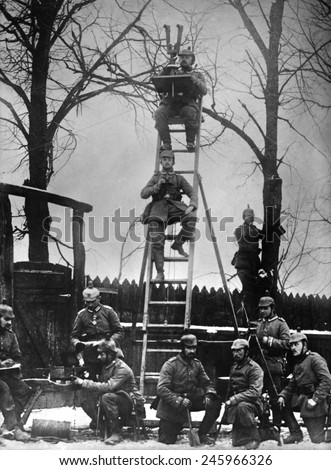 WWI. German observers using surveying instruments to measure the exact positions on the battlefield. Ca. 1915-1918. - stock photo