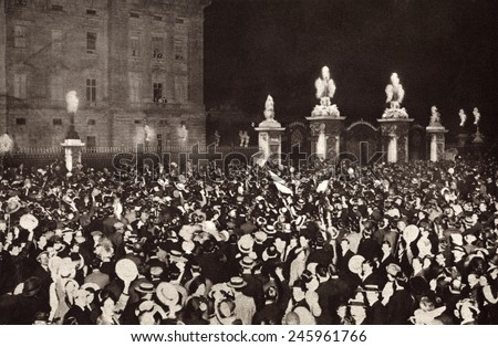 WWI. London crowds cheering the Royal Family on the Buckingham Palace balcony on the day Britain declared war on Germany and Austria-Hungary. August 4, 1914. - stock photo