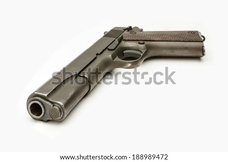 WWII G.I. 1911A1 .45 Caliber Pistol isolated White - stock photo