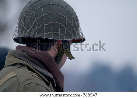 WWII Soldier in a winter setting. - stock photo