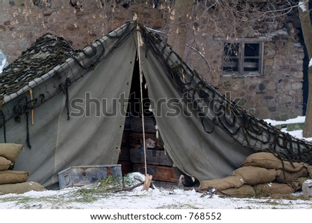 WWII US Army mobile camp in a winter setting. - stock photo