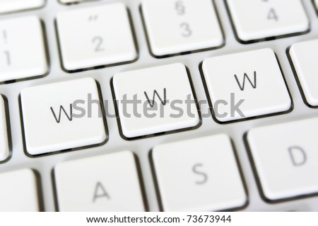 WWW written in keys on white keyboard. Concept for the world wide web or other internet related things. - stock photo