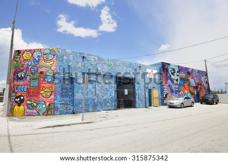 WYNWOOD - SEPTEMBER 2: Image of art murals on the wals at Wynwood which is a neeighborhood north of Downtown Miami known for it's abundance of graffiti and art on building walls September 2, 2015. - stock photo