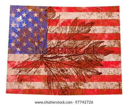 Wyoming state of the United States of America in grunge flag pattern isolated on white background - stock photo