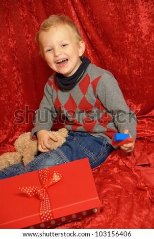 x-mas child with teddy - stock photo