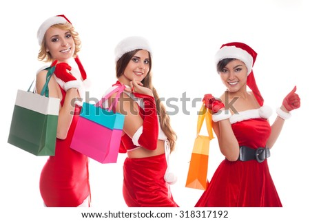 x-mas concept - smiling female in red costumes santa with colorful shopping bags - stock photo