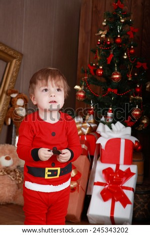 X-mas time. Little boy with presents - stock photo