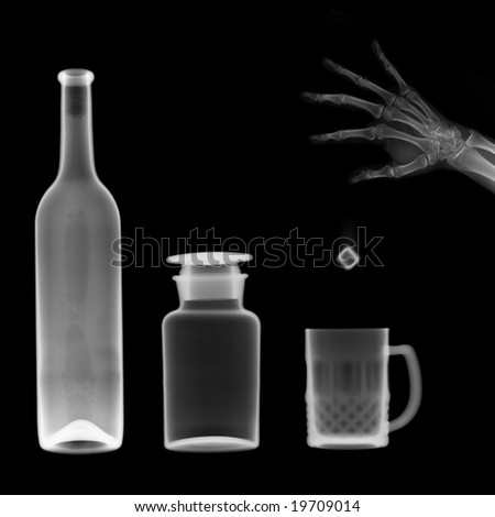 x-ray picture:bottle and mug,a hand throw a ice cube into the mug - stock photo