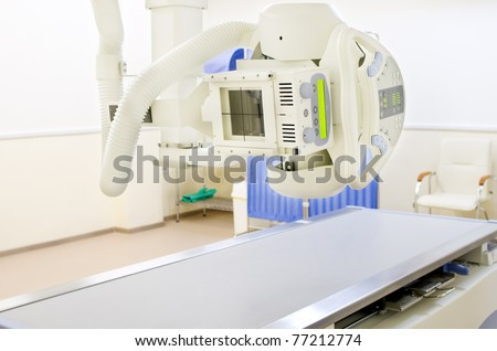 X-Ray system machine in contemporary medical center - stock photo