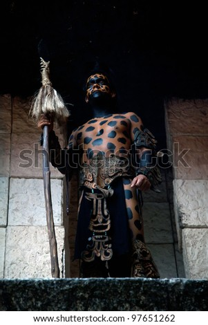 XCARET, MEXICO - MARCH 6: The Xcaret Show performer dressed as an ancient Mayan warrior on March 6, 2012 in Xcaret, Mexico. The show is the major attraction, featuring more than 300 artists on stage. - stock photo