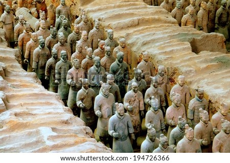 Xi'an, China - September 7, 2006:  A silent procession of hundreds of soldiers in the Pit #1 excavation site at the Museum of Terra Cotta Warriors of Emperor Qin Shihuang - stock photo