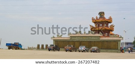 XIAMEN, CHINA, DECEMBER 1, 2013: people are walking in front of the guanyin temple in chinese city xiamen. - stock photo
